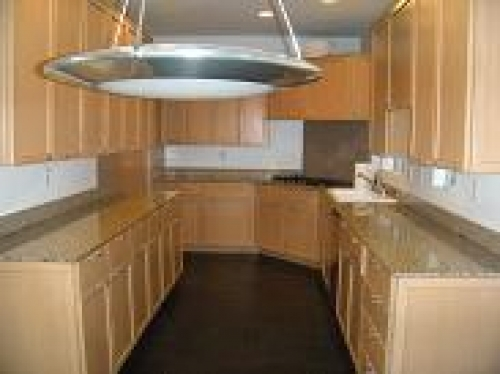 maple kitchen cabinet with granite countertops in